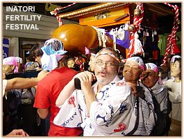 "Mark Schumacher carrying ""mikoshi"" or portable shrine at Fertility Festival in Inatori, Japan"