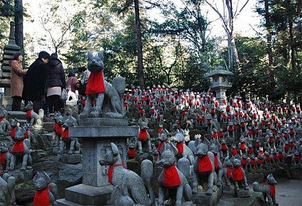 Toyokawa Inari Shrine - Fox Statues in Red Bibs
