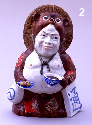 Tanuki holding tea cup and cookies
