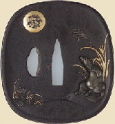 Tsuba (sword guard) with design of a tanuki drumming on its belly beneath the moon. Japanese, Mid-19th Century. MFA Collection.