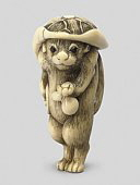 Ivory Tanuki Netsuke. http://www.christies.com/LotFinder/lot_details.aspx?from=searchresults&intObjectID=4981674&sid=f5234657-a43e-4b8a-916c-9d68190804e0