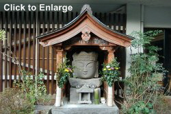 Usuki, Oita Prefecture. Modern. Replica of the famous head of Dainichi Nyorai.