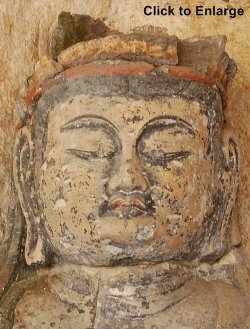 Usuki, Oita Prefecture. The famous 12th-century head of Dainichi Nyorai carved into the rock face.