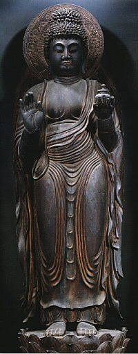 Standing Yakushi. Japan, Heian period, 9th century. Wood, singleblock construction, with touches of polychrome. 169.7 cm. Jingoji, Kyoto Prefecture.