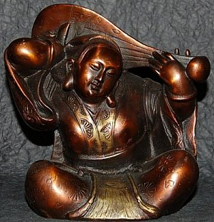 Modern metal statue of Benzaiten playing a lute