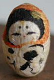 Mayu Daruma (Gestation Kami). This doll is made of silk.