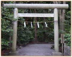 Shinto Torii, or Gate, decorated with the Shimenawa rope and white paper