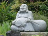 Hotei - stone statue at Zenyo-in in Inatori City