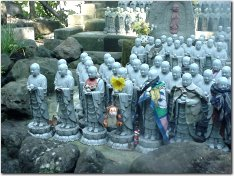 Jizo all dressed up (at Hase Dera in Kamakura)