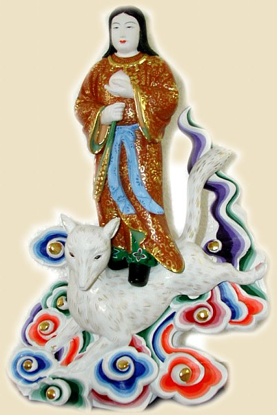 Female Oinari standing atop a white fox; modern Japanese ceramic
