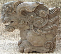 Wooden Shishi, typically found under the eave of Buddhist temples and Shinto shrines.